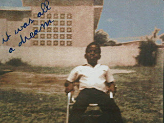 Little Biggie! Christopher Wallace as a young boy, sitting in a deck chair in the garden