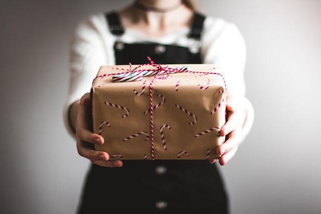 girl holding gift, unsplash.com