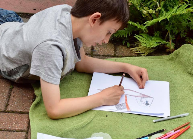 Boy colouring and drawing