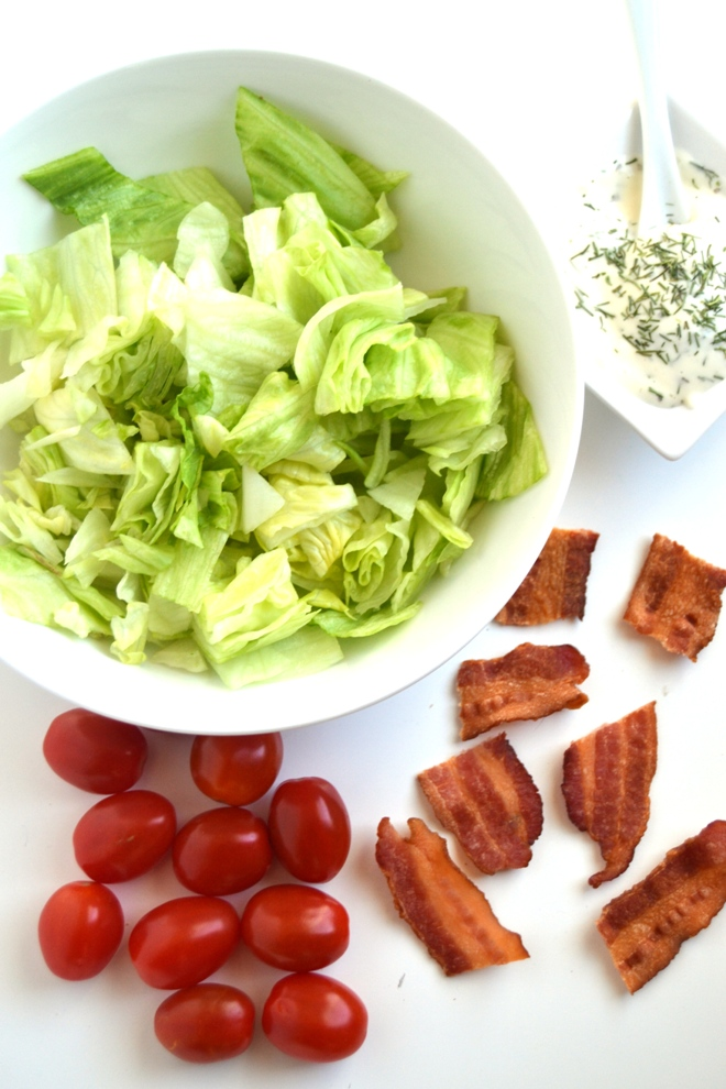BLT Bites combine your favorite bacon, lettuce and tomato combination all on a stick with a creamy dressing for an easy and tasty appetizer that is ready in 10 minutes! www.nutritionistreviews.com