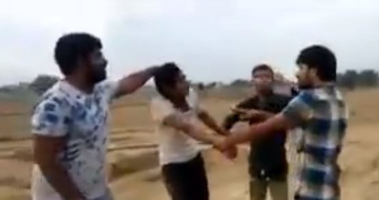 """A new video of cow vigilantes thrashing a man, allegedly in Rajasthan, has surfaced.  His crime: carrying meat the side luggage carrier of his motorbike.  Three vigilantes are seen beating up the guy ignoring his pleas for mercy. One of them is heard saying, """"Will you kill my mother…"""" in a reference to the hallowed status of the Hindutva's sacred animal."""