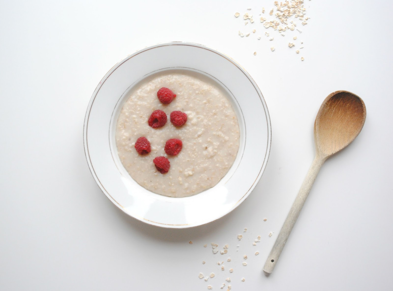 porridge fresh fruit healthy breakfast raspberries wooden spoon gold trim bowl white raspberries homeware