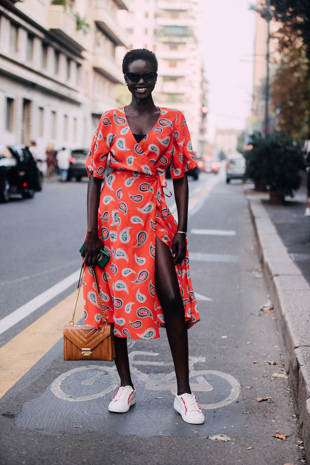 25 Best Print Dresses for Summer Fall Transitional Style —Adut Akech Model Street Style Red Ruffled Wrap Dress and Sneakers