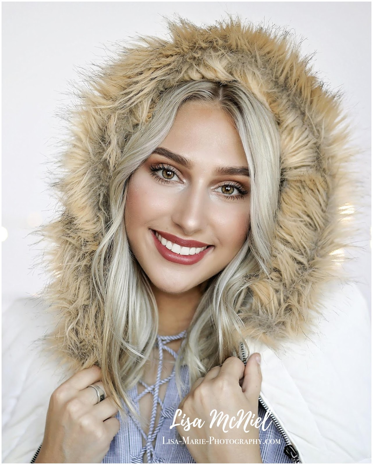 beautiful girl close up with fur hood