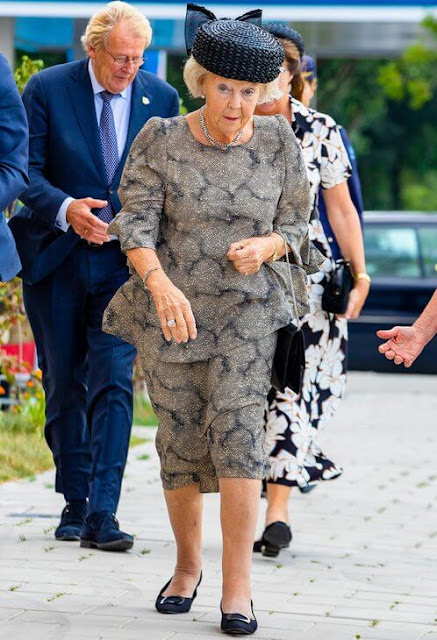 Princess Beatrix wore a grey embroidered print outfit, top and skirt at the opening of Safe Veste in Capelle aan den IJssel