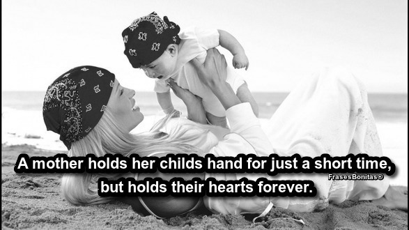 A mother holds her child's hand for just a short time, but holds their hearts forever.