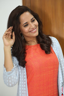 Actress Anasuya Bharadwaj in Orange Short Dress Glam Pics at Winner Movie Press Meet February 2017 (78).JPG