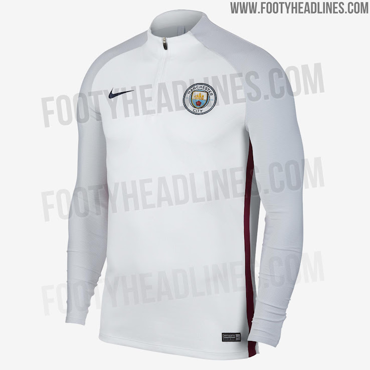 fc2fe7b9 A smart look, the Manchester City 2018 training top is white with a dark  blue Swoosh and a red stripe on each side. The sleeves are light gray, ...