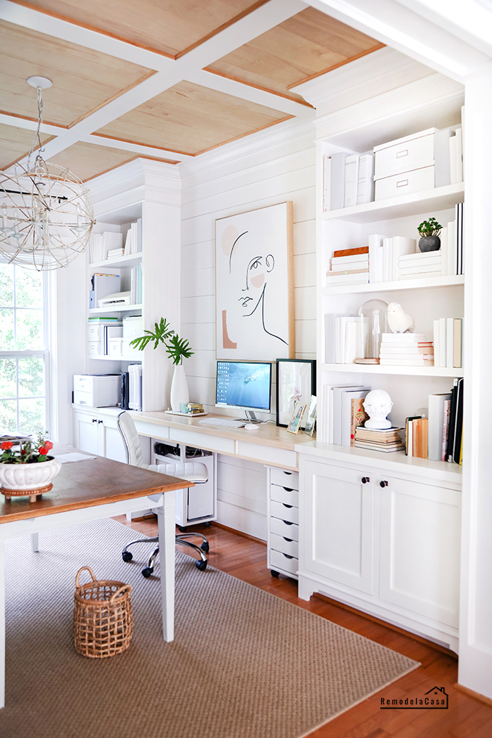 white office with wooden ceiling