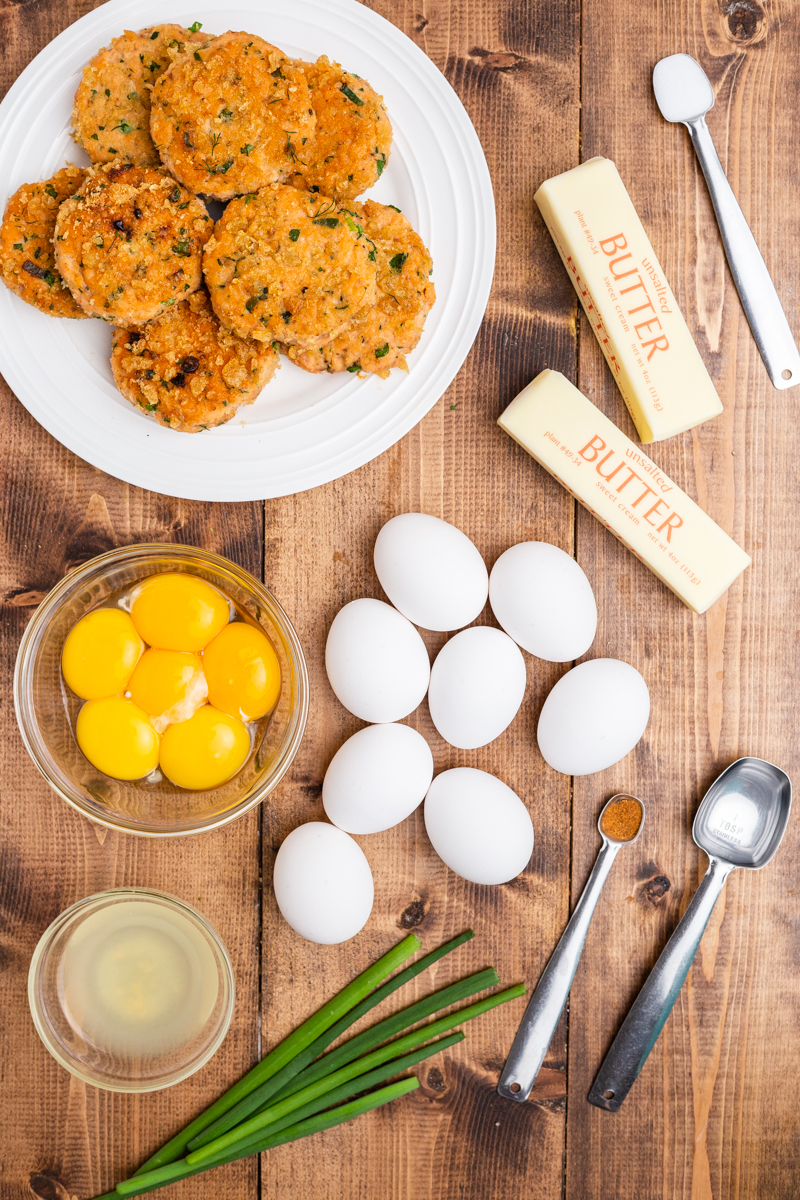 Ingredients needed to make Keto Salmon Eggs Benedict on a wooden table.