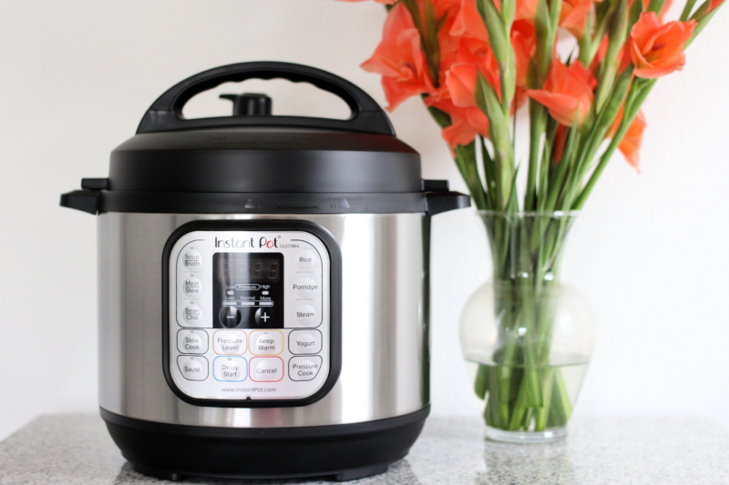 an instant pot and flowers on a table