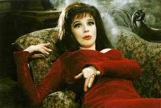 Still from Carry on Screaming of Fenella Fielding character lying on chair.