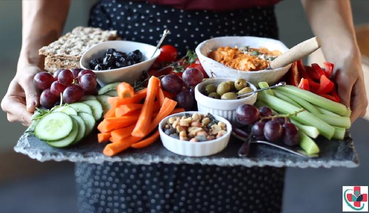Woman displaying various meals