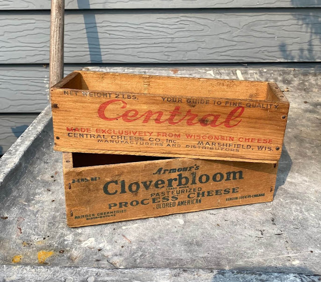 Photo of two vintage wooden cheese boxes