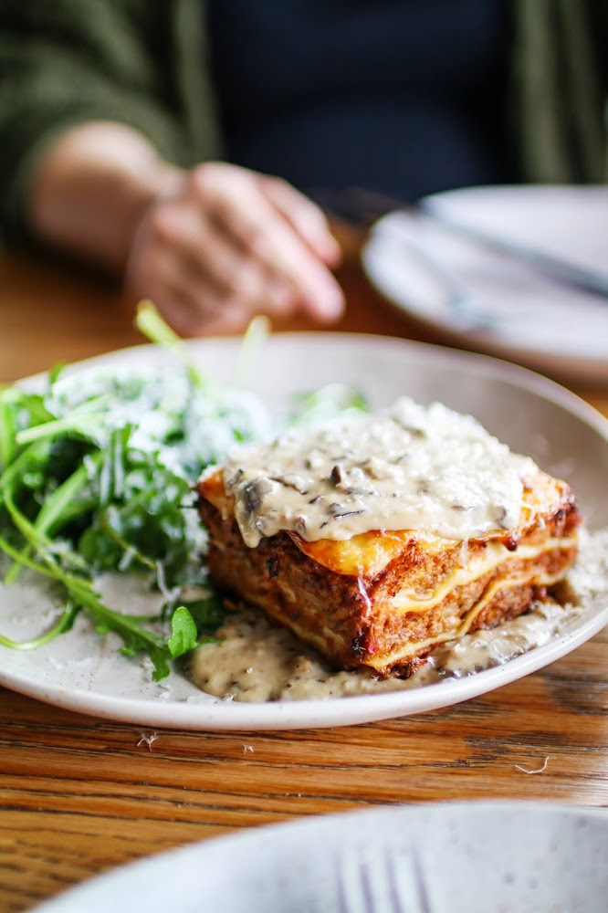Lasagne with Salad at Acre Eatery