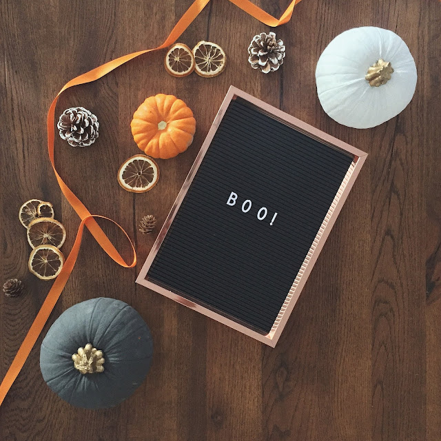 Autumn and Halloween decorations on flatlay.