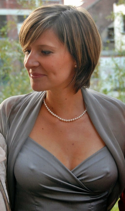 Older woman is grey evening dress