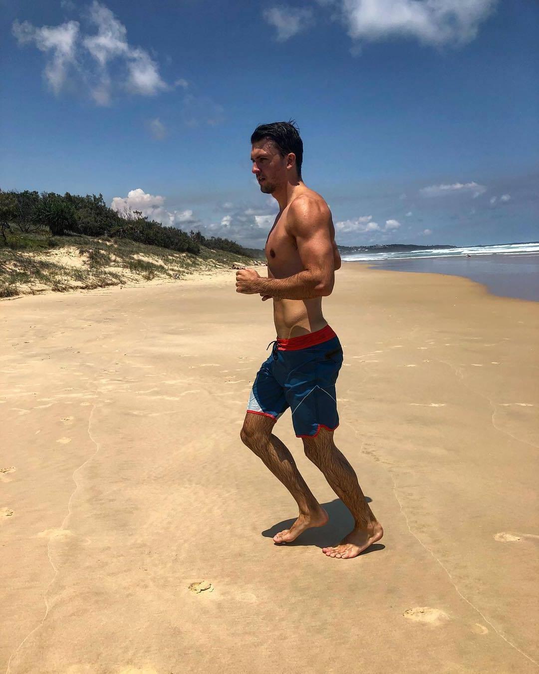 handsome-bare-chest-slim-fit-male-runner-beach-wet-hairy-legs