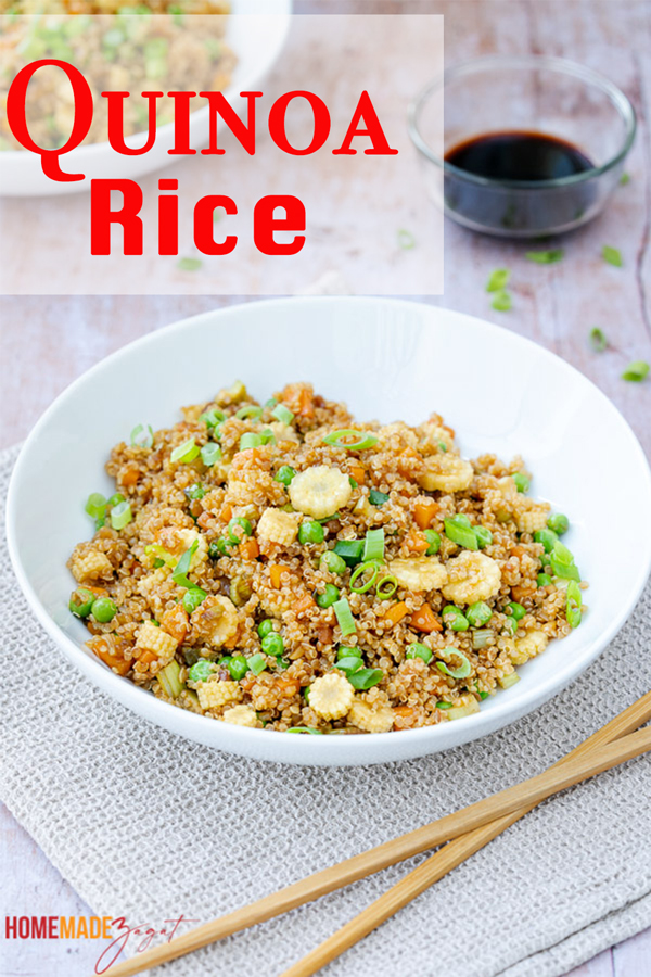 Full bowl of quinoa rice  finished with chop sticks and extra soy sauce