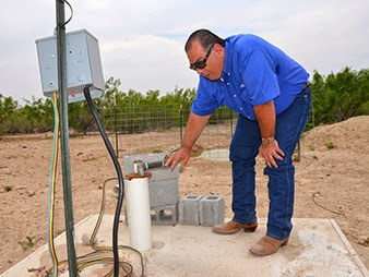 Farmer Jorge Espinoza is trying out a new solar-powered water pump to cut his costs of irrigation. (Credit: Department of Agriculture) Click to enlarge.