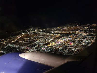 View of Las Vegas at night from over airplane wing
