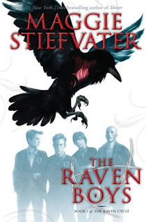A large flying raven with a glowing red heart is superimposed over the image of four teenage boys in matching school uniforms.