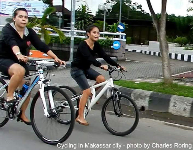 Some women were cycling as a late afternoon sports and sightseeing activity in Makassar city.