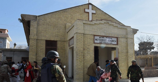 Suicide bombers storm church and detonate explosives as congregation worships in Pakistan church attack
