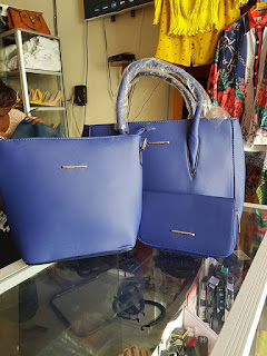 Mombasa blue hand bags with slivery, shinny huddles.