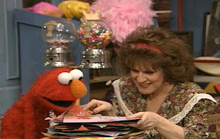 Elmo and Ruthie appear on the scene they look Elmo's drawings and talk about them. Sesame Street The Best of Elmo