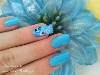 nail art fiore estivo azzurro