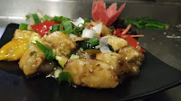 Serving a garnished plate of ginger honey paneer for ginger paneer recipe