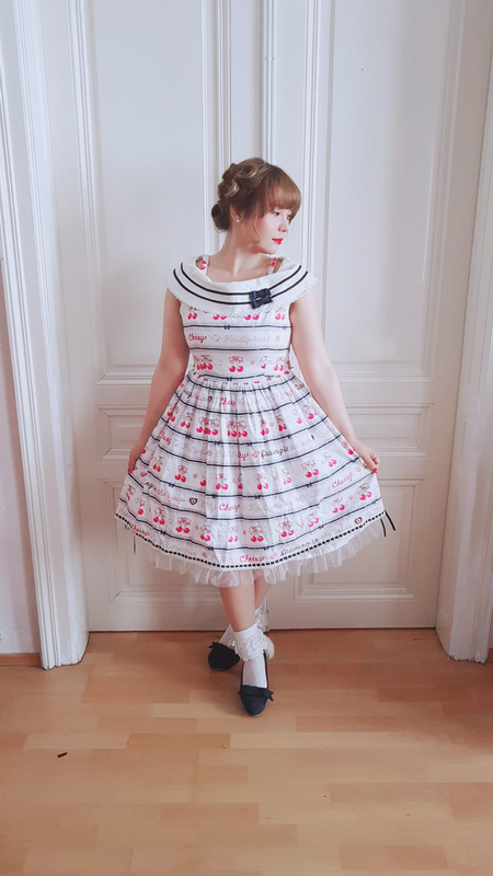 asian looking girl wears a lolita dress from baby the stars shine bright