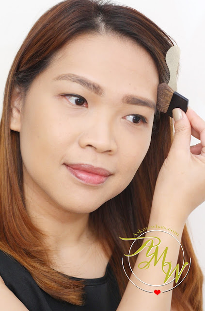 a photo of AskMeWhats Nikki Tiu wearing Maybelline V-Face Duo Powder by FaceStudio Medium Dark