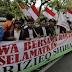 Demo Mahasiswa Membawa Spanduk bertuliskan 'Jangan Halangi Habib Rizieq Shihab Pulang Indonesia'