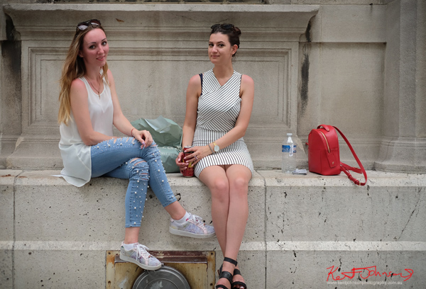 Two women talking at, Parvis Notre-Dame - Pl. Jean-Paul II. If you're going to the Cité.. Shots from Paris on June 26 2017 for Street Fashion Sydney.