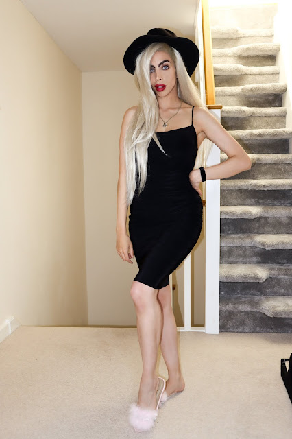 The Femme Luxe Black Ruched Midi Bodycon Dress in model Taylor