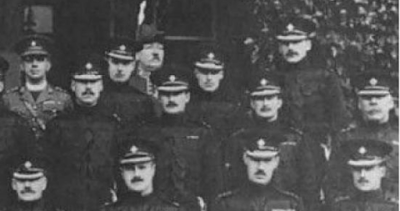 Portion of a 1922 photograph of the officers of the 1st Battalion, Irish Guards, taken at Aldershot in 1926. For this portion of the photograph, the third row caption has: Rev. J. McGuinness, Chaplain; 2/Lt Montagu-Douglas; Capt and Quartermaster H. Hicke MBE, MC; Lt. R.C. Alexander