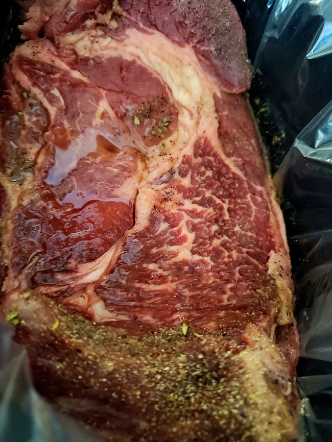 this is chuck roast in the slow cooker with wine and herbs