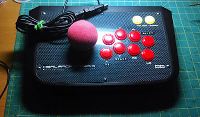 HORI Real Arcade Pro arcade stick, fitted with an analogue stick with easy grip sponge tennis ball top.