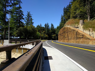 View of Skyline Boulevard and a new retaining wall as viewed from the bridge over the new gully, Los Gatos, California