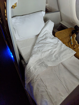 Emirates First Class private suite made up for sleeping