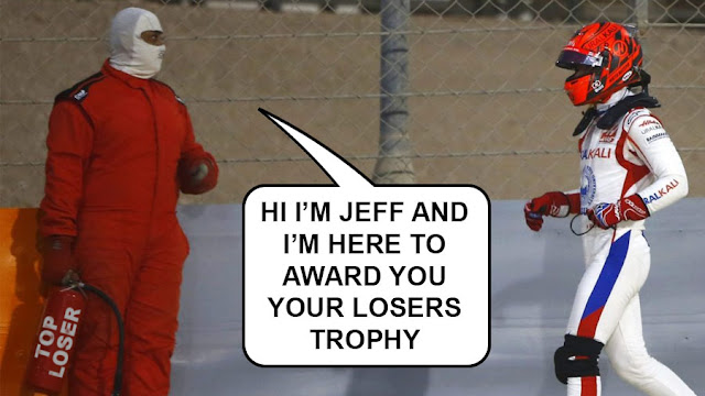 Bahrain GP Mazapin with a fire marshall who says HI I'M JEFF AND I'M HERE TO AWARD YOU YOUR LOSERS TROPHY