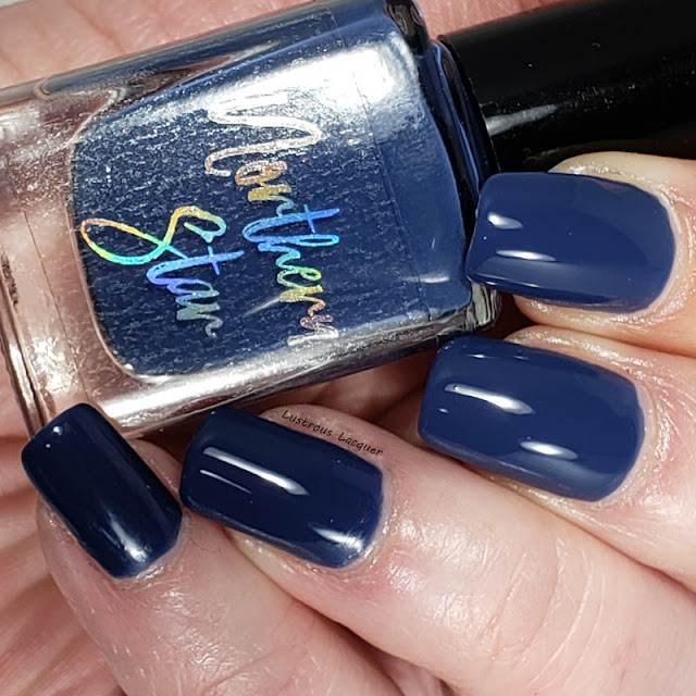 Dark Dusty Blue Nail polish with a glossy creme finish