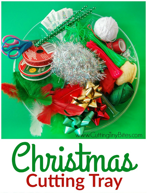 This Christmas Cutting Tray is fun and easy activity for developing scissor skills in preschoolers or kindergartners. Let them snip away with festive holiday fine motor work!