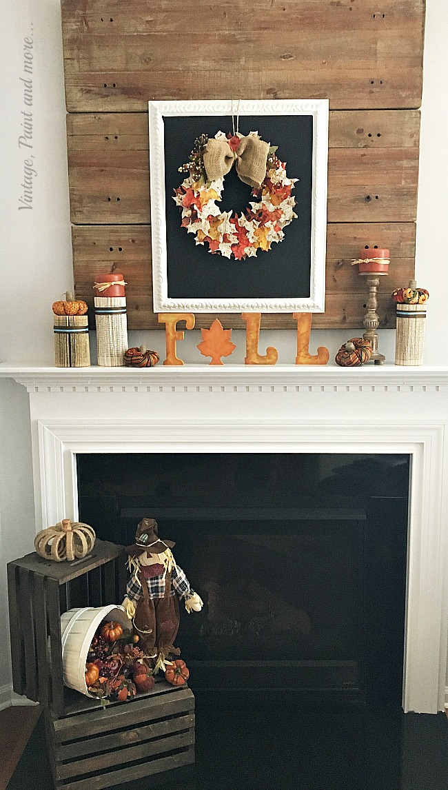 Vintage, Paint and more... fall mantel with farmhouse chalkboard, vintage paper leaf wreath and book page columns, fabric pumpkins, and wood crates