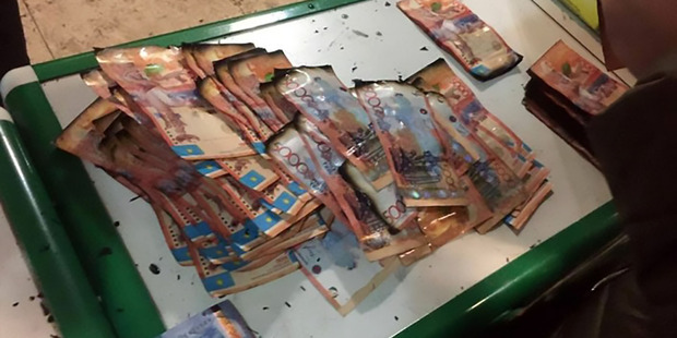 Bank robbers burn ATM, all the money they're trying to steal