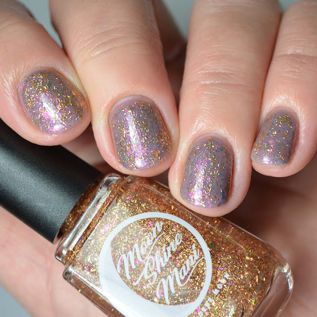 gold flakie nail polish topper four finger swatch