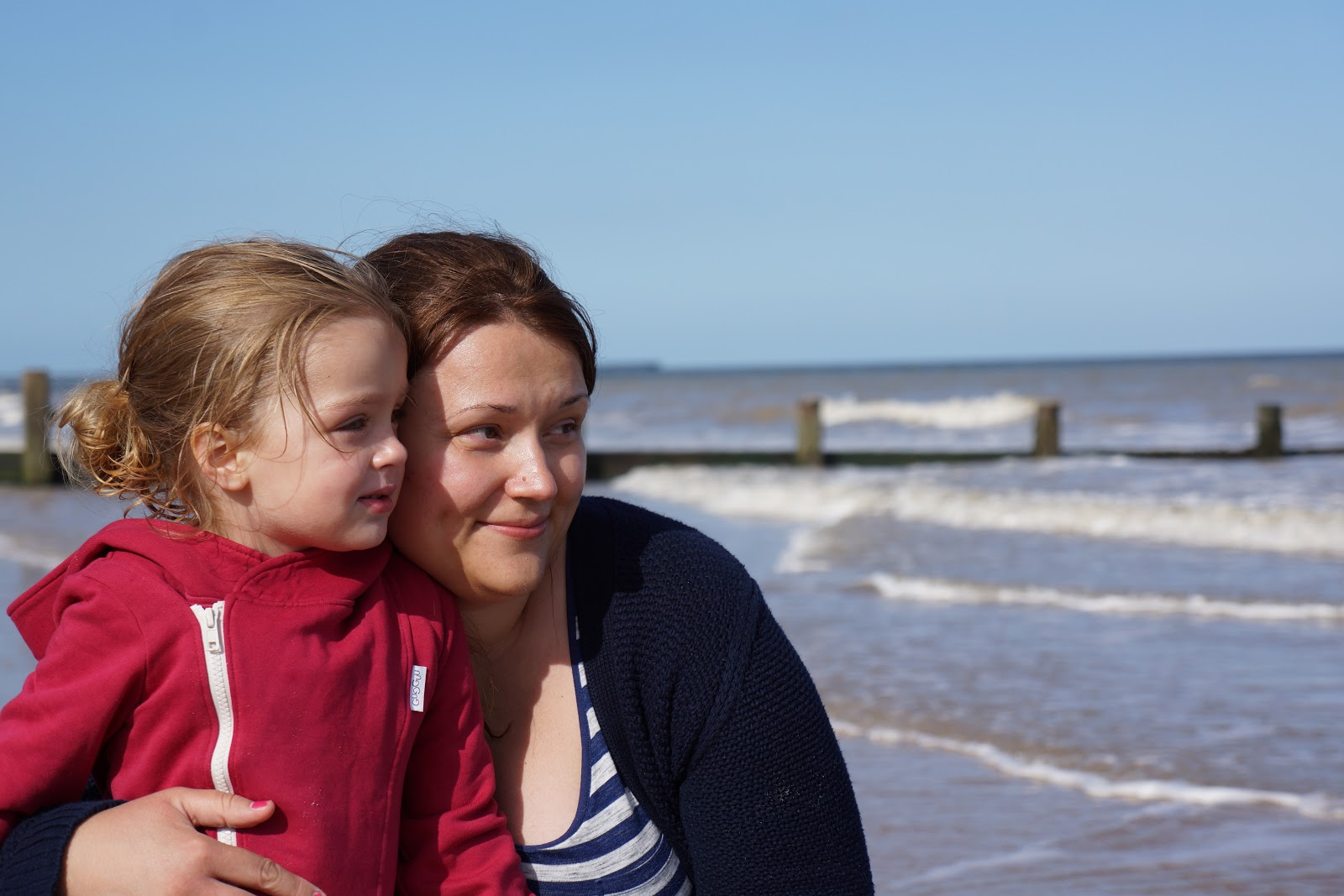 mum and daughter on beach