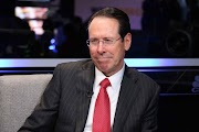 AT&T bows to pressure from activist investor Elliott, CEO will stay on through 2020